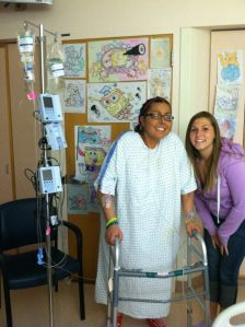 Me jaundiced, hooked up to my IV patiently waiting with my cousin, Courtney, for a matching transplant in very late April 2012 just a few days before my transplant