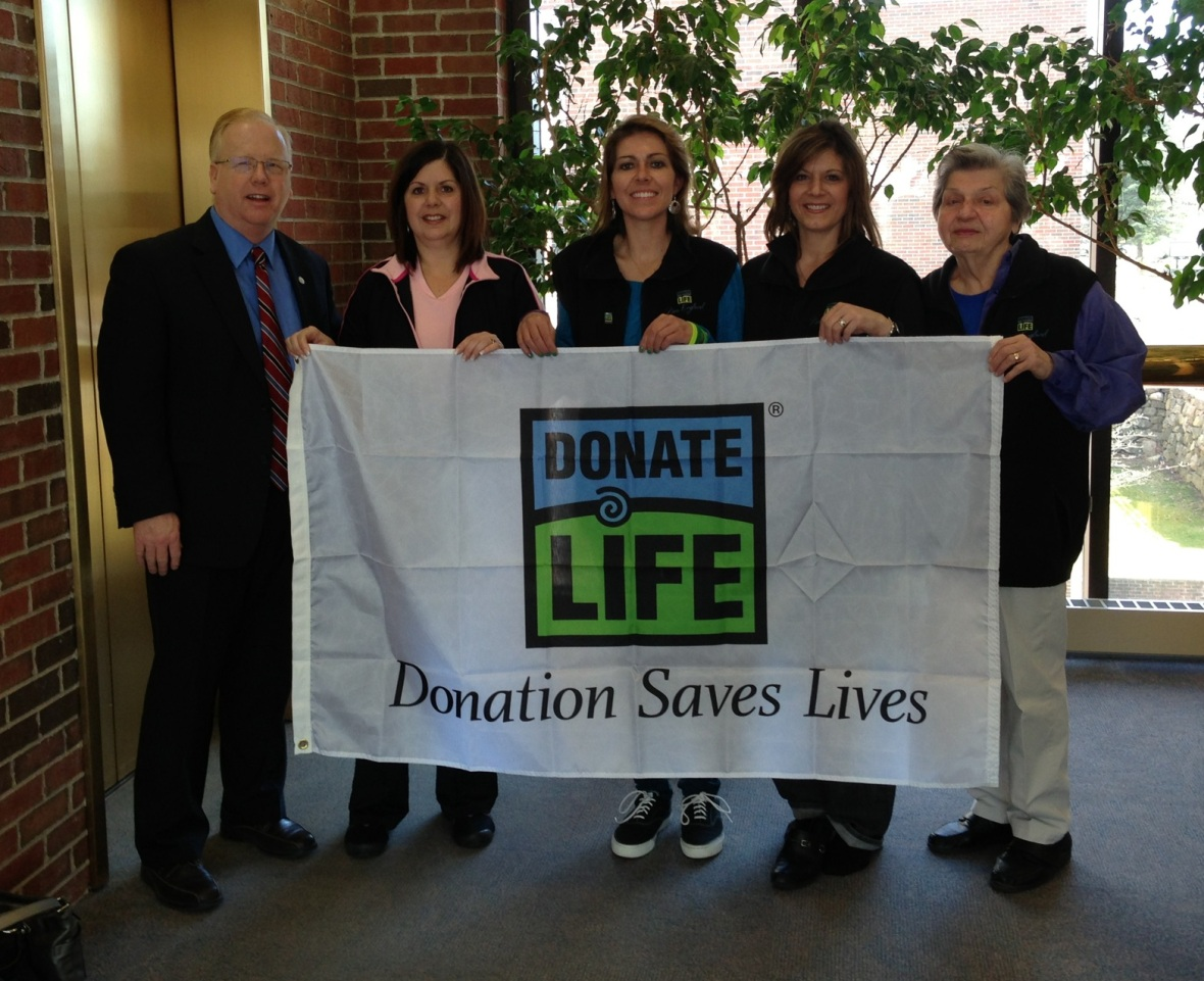 With our mayor, Mayor Boughton (Danbury, CT) at City Hall with the Donate Life flag which is raised for the month of April for Donate Life Awareness month (Left to Right: Mayor Boughton, my aunt Dana, me, my aunt Caryn, my grandmother Rose).