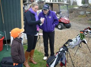 Monique Gesualdi, right, of Danbury, chats with Carrie DeMunda, of Danbury, and Frankie DeMunda, 6, during a kids golf lesson at Richter Park Golf Course in Danbury, Conn. Tuesday, April 29, 2014. Gesualdi underwent a liver transplant and two brain surgeries two years ago and had a successful recovery. She now helps out with childrens golf lessons at Richter Park and hopes to teach golf professionally someday. Photo: Tyler Sizemore