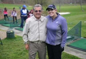 Monique Gesualdi and her grandfather Emilio Plante, of Danbury, pose at Richter Park Golf Course in Danbury, Conn. Tuesday, April 29, 2014. Gesualdi underwent a liver transplant and two brain surgeries two years ago and had a successful recovery. She now helps out with childrens golf lessons at Richter Park and hopes to teach golf professionally someday. Photo: Tyler Sizemore